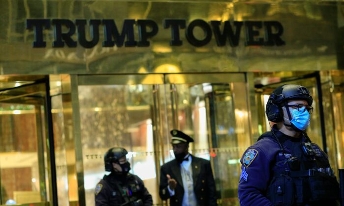 NYPD officers stand guard in front on Trump Tower on 5th Avenue the night before the presidential election, in New York, N.Y., on Nov. 2, 2020. (Kena BetancurAFP via Getty Images)