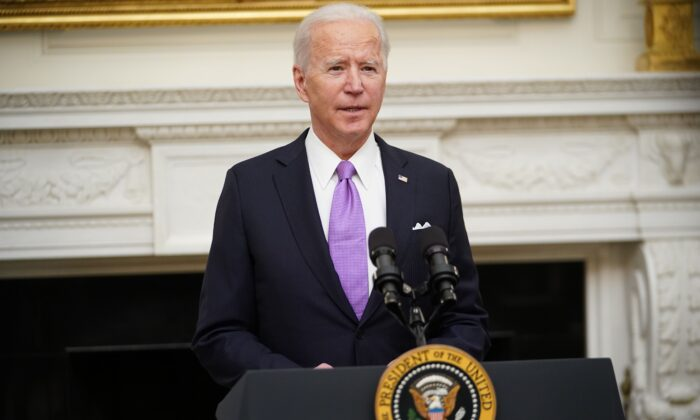 President Joe Biden speaks about the CCP virus response before signing executive orders in the State Dining Room of the White House in Washington, on Jan. 21, 2021. (Mandel Ngan/AFP via Getty Images)