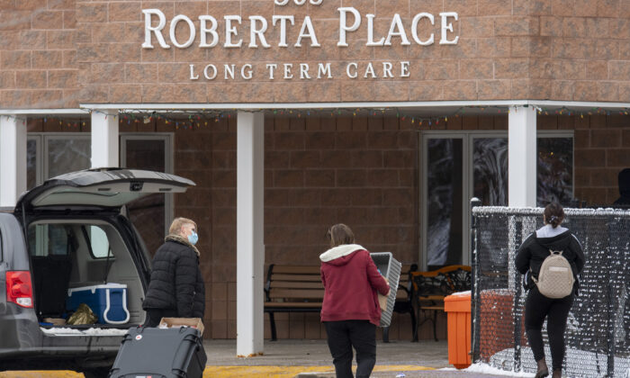 Workers arrive at the Roberta Place Long Term Care home in Barrie, Ont., Canada, on Jan. 18, 2021. (Frank Gunn/The Canadian Press)