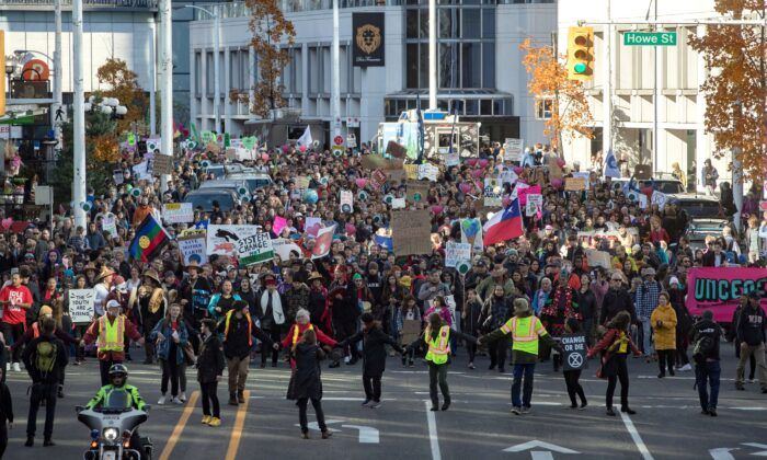 A student-led climate change march makes its way through downtown Vancouver on Oct. 25, 2019. (The Canadian Press/Darryl Dyck)