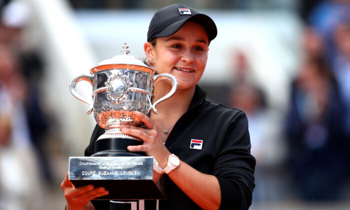 Ashleigh Barty of Australia celebrates victory with the trophy following the ladies singles final against Marketa Vondrousova of The Czech Republic during Day fourteen of the 2019 French Open at Roland Garros on June 08, 2019 in Paris, France. (Photo by Clive Brunskill/Getty Images)