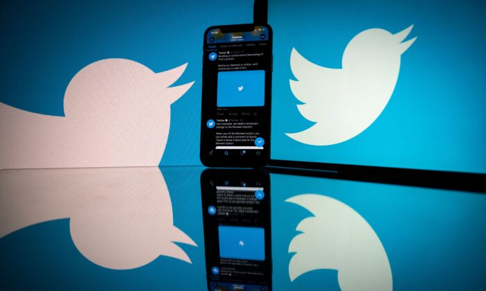 The logo of US social network Twitter displayed on the screen of a smartphone and a tablet in Toulouse, France, on Oct. 26, 2020. (Lionel Bonaventure/AFP via Getty Images)