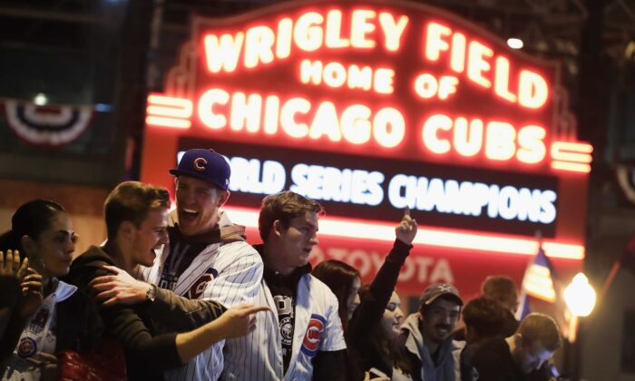 Chicago Cubs fans celebrate outside Wrigley Field after the Cubs defeated the Cleveland Indians in Game 7 of the 2016 World Series, in Chicago, Ill., on Nov. 2, 2016. (Scott Olson/Getty Images)