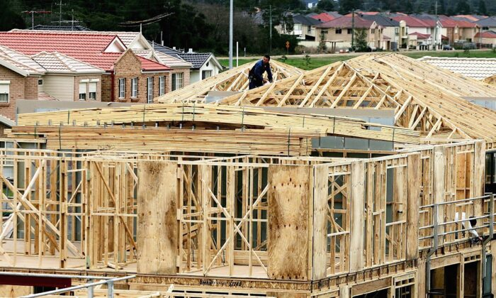 A builder works on a house under construction amongst an established suburb August 2, 2006 in Sydney, Australia. (Ian Waldie/Getty Images)