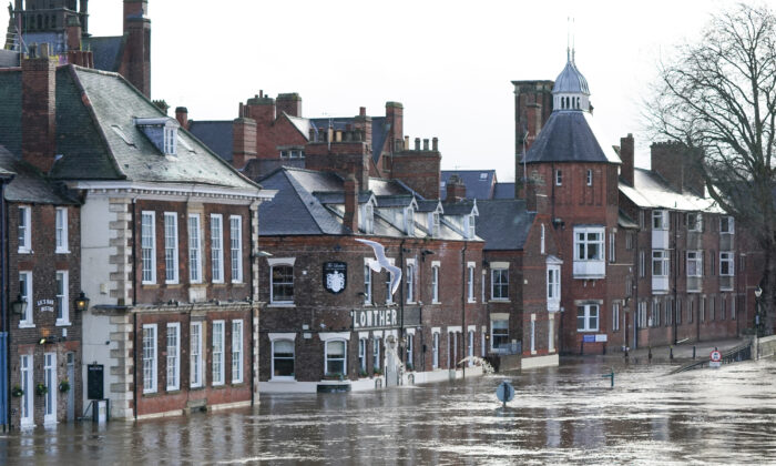 The River Ouse in York floods as rain and recent melting snow raise river levels in York, England on Jan. 21, 2021. (Ian Forsyth/Getty Images)