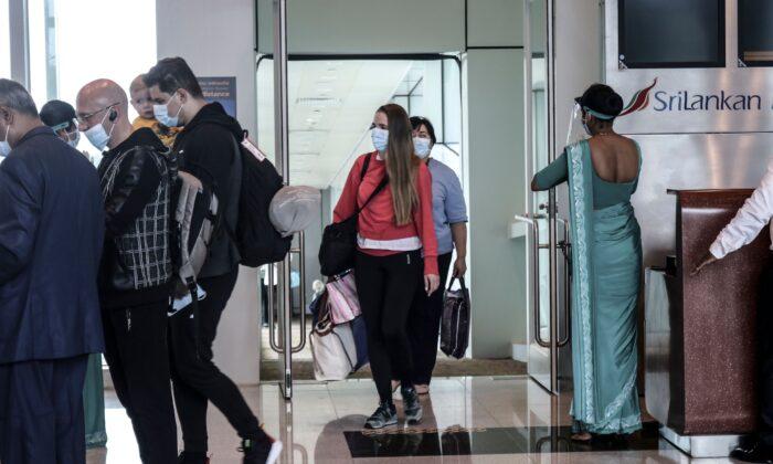 Ukraine passengers arrive at Mattala Rajapaksa International Airport, in Mattala, Sri Lanka, on Dec. 28, 2020. (STR/AFP via Getty Images)