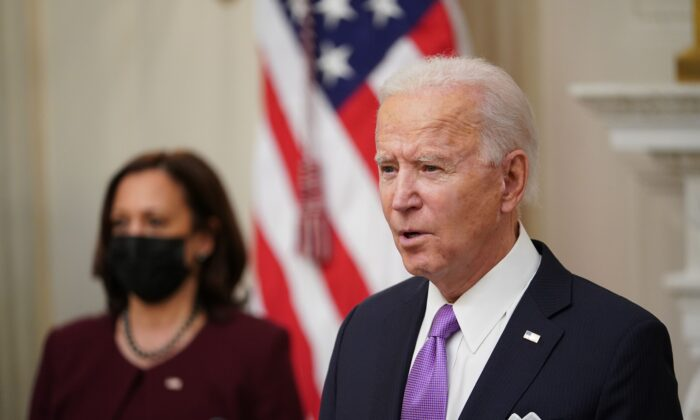 President Joe Biden speaks about the Covid-19 response as Vice President Kamala Harris (L) looks on before signing executive orders in the State Dining Room of the White House in Washington on Jan. 21, 2021. (Mandel Ngan/AFP via Getty Images)