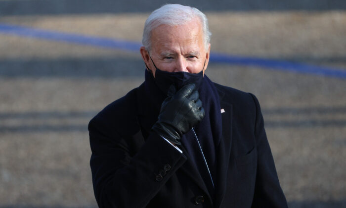 President Joe Biden walks the abbreviated parade route after Biden's inauguration in Washington on Jan. 20, 2021. (Patrick Smith/Getty Images)