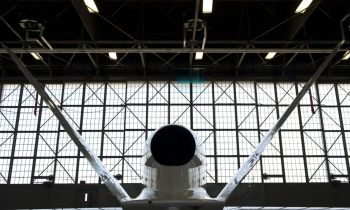 A NASA Global Hawk unmanned aerial vehicle, or drone aircraft, is stored inside an airplane hangar during a Hurricane and Severe Storm Sentinel, or HS3, mission at NASA's Wallops Flight Facility in Wallops Island, Va., on Sept. 10, 2013. (Saul Loeb/AFP via Getty Images)