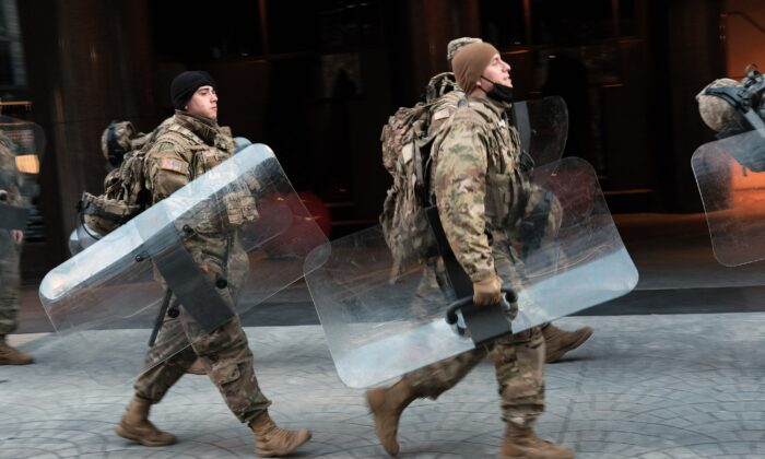 Members of the National Guard walk through the streets of Washington on Jan. 20, 2021. (Spencer Platt/Getty Images)