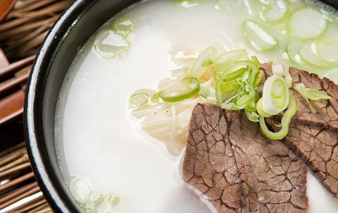 Unlike clear bone broths, seolleongtang is an opaque, creamy white, achieved by boiling—not simmering—the bones, coaxing out all of the flavor, collagen, marrow, and fat. (TMON/Shutterstock)