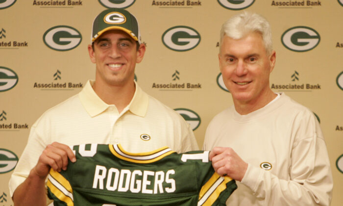 Green Bay Packers general manager Ted Thompson stands next to the team's first-round pick, California quarterback Aaron Rodgers, during an NFL football a news conference in Green Bay, Wis., on April 24, 2005. (Mike Roemer/AP Photo)