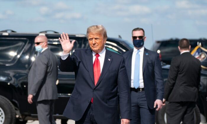 Outgoing U.S. President Donald Trump waves after landing at Palm Beach International Airport in West Palm Beach, Fla., on Jan. 20, 2021. (Alex Edelman/AFP via Getty Images)