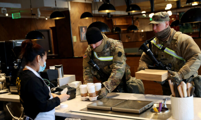Members of Pennsylvania 112th Infantry Regiment National Guard are served coffee at a D.C. restaurant on Jan. 16, 2021. (Joe Raedle/Getty Images)