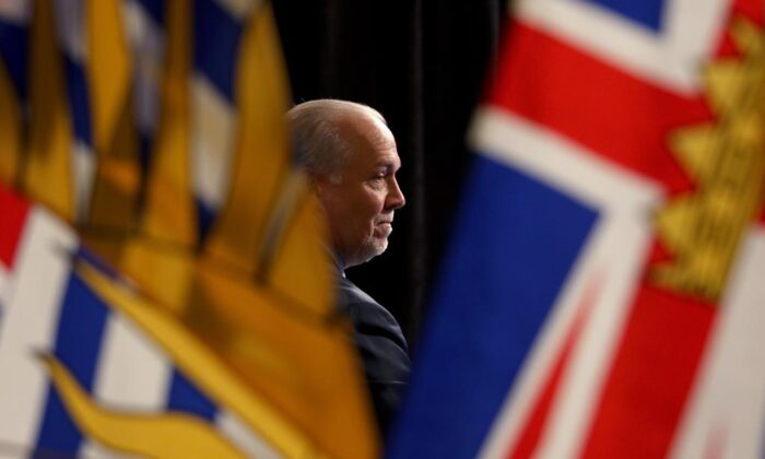Premier John Horgan attends a press conference in the rotunda at Legislature in Victoria, B.C., on May 6, 2020. (Chad Hipolito/The Canadian Press)