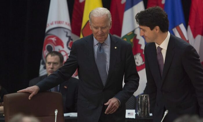 Joe Biden, then the U.S. vice-president, and Prime Minister Justin Trudeau take their seats at the start of the First Ministers and National Indigenous Leaders meeting in Ottawa, on Dec. 9, 2016. (Adrian Wyld/The Canadian Press)