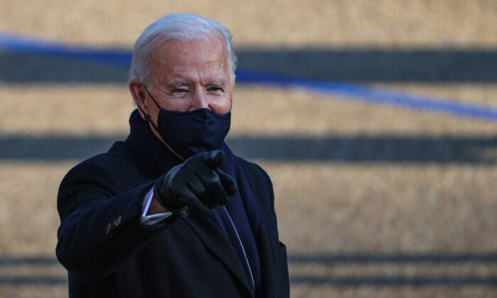 President Joe Biden walks the abbreviated parade route after Biden's inauguration on January 20, 2021 in Washington. (Patrick Smith/Getty Images)