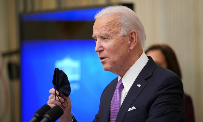 President Joe Biden speaks about the CCP virus response before signing executive orders in the State Dining Room of the White House in Washington on Jan. 21, 2021. (Mandel Ngan/AFP via Getty Images)