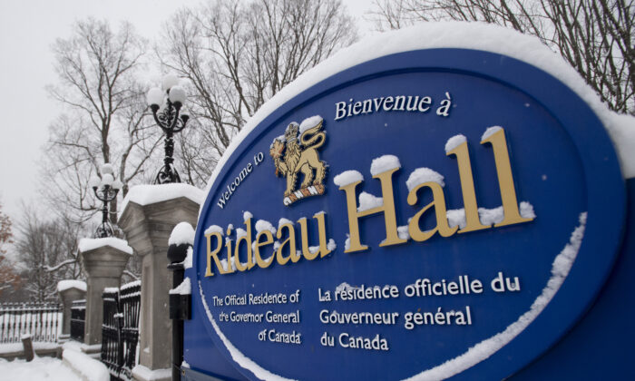 A sign on the wall surrounding Rideau Hall on Jan. 21, 2021. Gov.-Gen. Julie Payette is resigning. The news comes as the results of an investigation into allegations of a toxic workplace environment at Rideau Hall are expected to be released. (Adrian Wyld/The Canadian Press)
