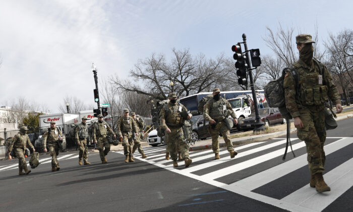 National Guard troops around the U.S. Capitol, in Washington, on Jan. 21, 2021. (Rebecca Blackwell/AP Photo)