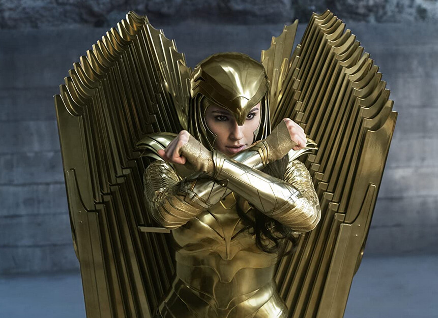 "woman in golder armor and helmet in ""Wonder Woman 1984"""