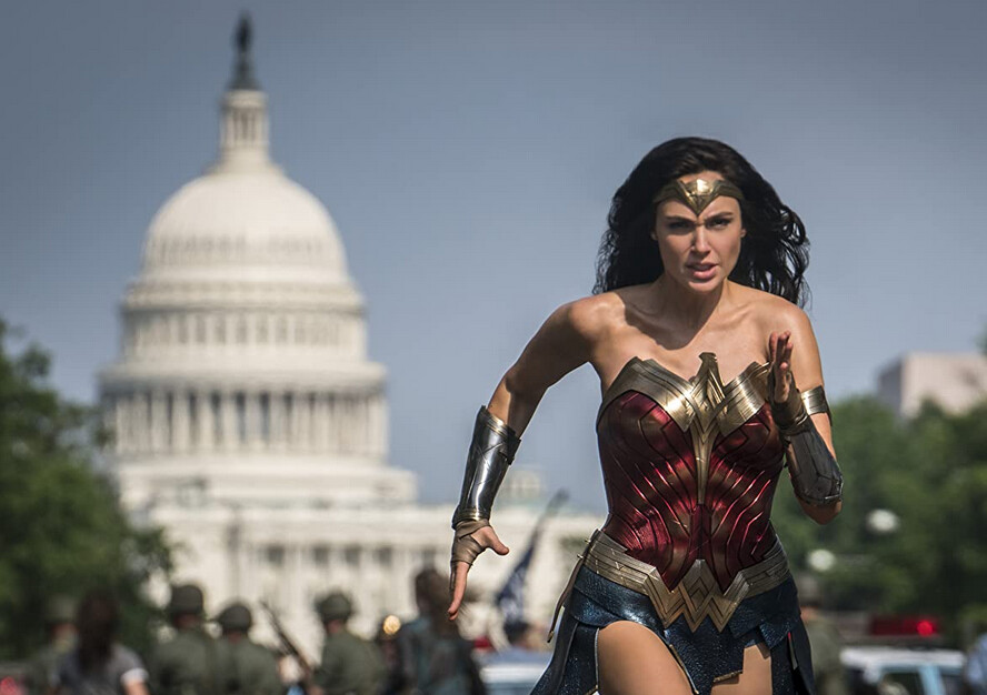 "woman in superhero costuming running in ""Wonder Woman 1984"""