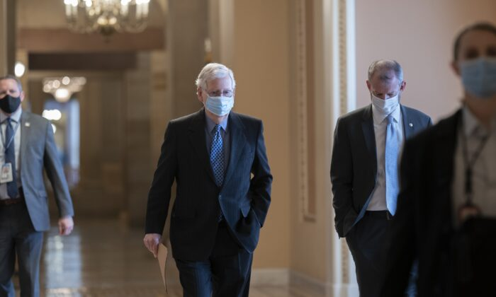 Senate Minority Leader Mitch McConnell (R-Ky.) walks on Capitol Hill in Washington on Jan. 21, 2021. (J. Scott Applewhite/AP Photo)