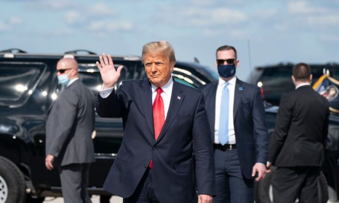 Outgoing President Donald Trump waves after landing at Palm Beach International Airport in West Palm Beach, Florida, on Jan. 20, 2021. (Alex Edelman/AFP via Getty Images)