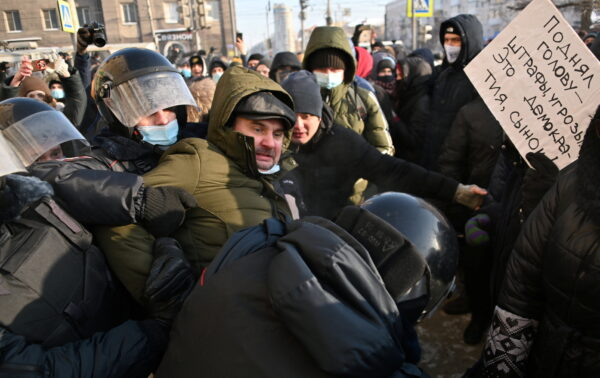 Police restrain man during Moscow rally