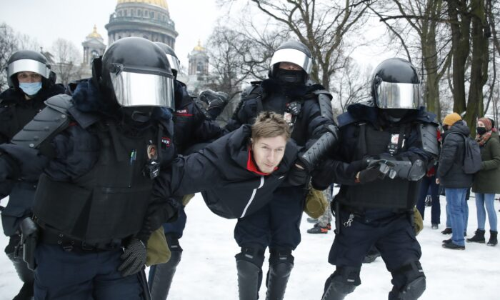 Police detain a man during a protest against the jailing of opposition leader Alexei Navalny in People gather in St. Petersburg, Russia, on  Jan. 23, 2021. (Dmitri Lovetsky/AP Photo)