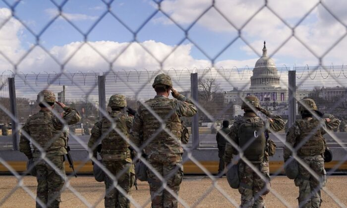 National Guard members salute in front of the U.S. Capitol building in Washington, Jan. 20, 2021. (Allison Shelley/Reuters)