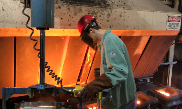 A worker pours hot metal at the Kirsh Foundry in Beaver Dam, Wis., on April 12, 2018. (Timothy Aeppel/Reuters)