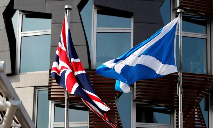A Scottish flag flies next to British Union Jack flag outside the Scottish Parliament in Edinburgh, Scotland, Britain, on April 24, 2019. (Russell Cheyne/Reuters)