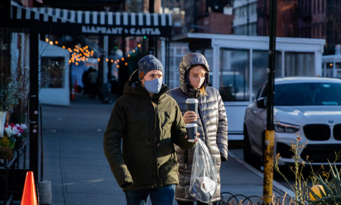 People wearing protective face masks walk on the street in New York on Jan. 20, 2021. (Chung I Ho/The Epoch Times)