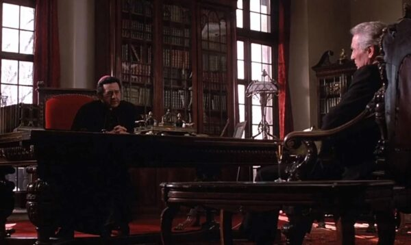 _Bishop talking with a man in his office