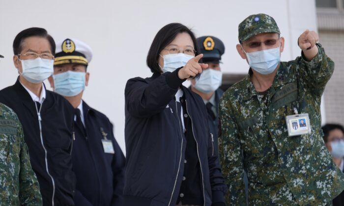 Taiwan's President Tsai Ing-wen (C) listens while inspecting military troops in Tainan, Taiwan, on Jan. 15, 2021. (Sam Yeh/AFP via Getty Images)