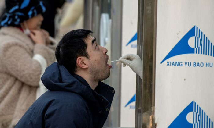 People are tested for COVID-19 in Beijing, on Jan. 23, 2021. (NOEL CELIS/AFP via Getty Images)