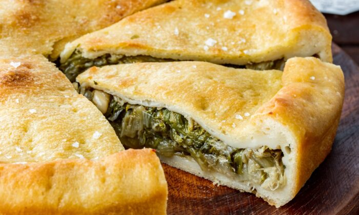 Bitter escarole, tamed by a medley of Mediterranean flavors, is the protagonist of this savory Neapolitan pie. (Giulia Scarpaleggia)