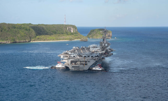The U.S. Navy aircraft carrier USS Theodore Roosevelt departs from Apra Harbor, Guam, on May 21, 2020. (U.S. Navy/Mass Communication Specialist Seaman Kaylianna Genier/Handout via Reuters)
