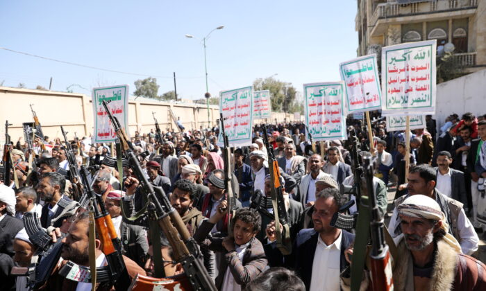 Houthi supporters hold up their weapons during a demonstration against the United States' decision to designate the Houthis as a foreign terrorist organization, in Sanaa, Yemen, on Jan. 20, 2021. (Khaled Abdullah/Reuters)