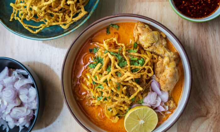 Khao soi is served with springy egg noodles and an assortment of toppings, including a crown of crispy fried noodles. (Sumate Treekajornsak/Shutterstock)