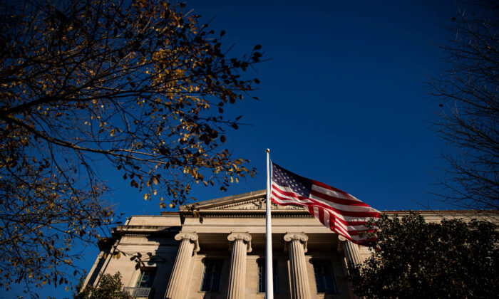 A U.S. flag waves outside the U.S. Department of Justice Building in Washington on Dec. 15, 2020. (Al Drago/Reuters)