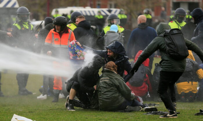 Police uses a water canon during a protest against COVID-19 restrictions, in Amsterdam, Netherlands, on Jan. 24, 2021. (Eva Plevier/Reuters)