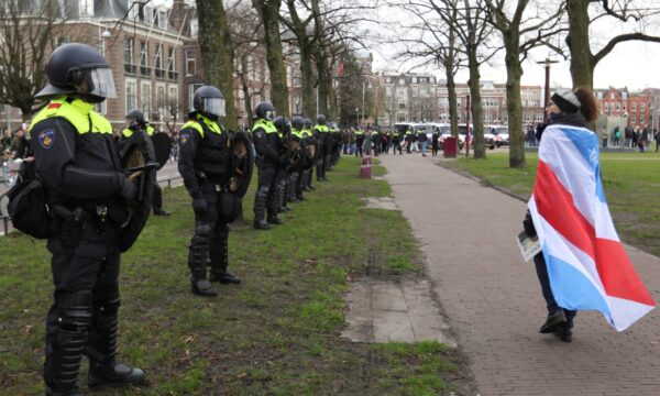 Police officers line up during a protest