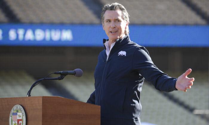 Gov. Gavin Newsom addresses a press conference at Dodger Stadium in Los Angeles on Jan. 15, 2021. (Irfan Khan/Los Angeles Times via AP, Pool)
