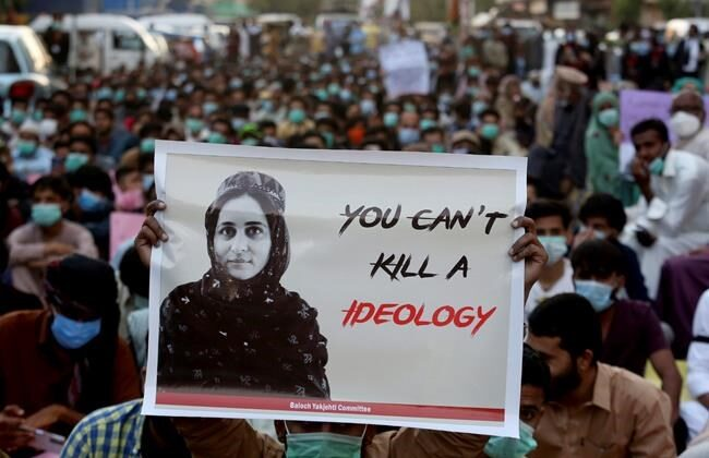 Supporters of Baloch political activist Karima Baloch hold her portrait during a demonstration to condemn her killing, in Karachi, Pakistan in this Dec. 24, 2020 file photo. (AP Photo/Fareed Khan, File)