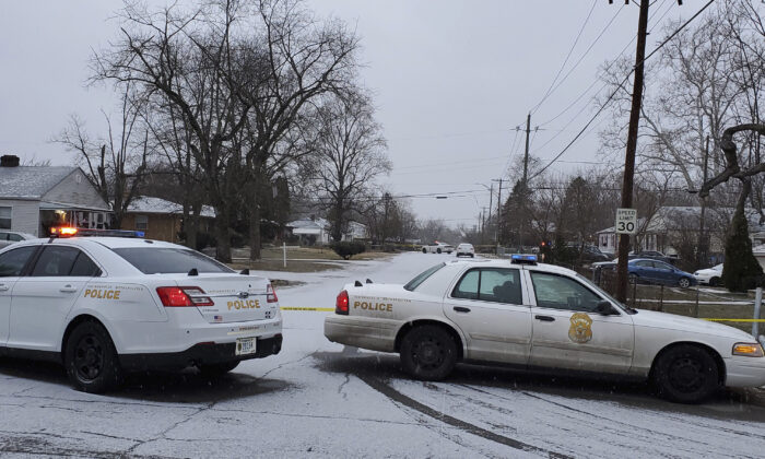 Indianapolis Metropolitan Police Department work the scene on Jan. 24, 2021 in Indianapolis where five people, including a pregnant woman, were shot to death. (Justin L. Mack/The Indianapolis Star via AP)