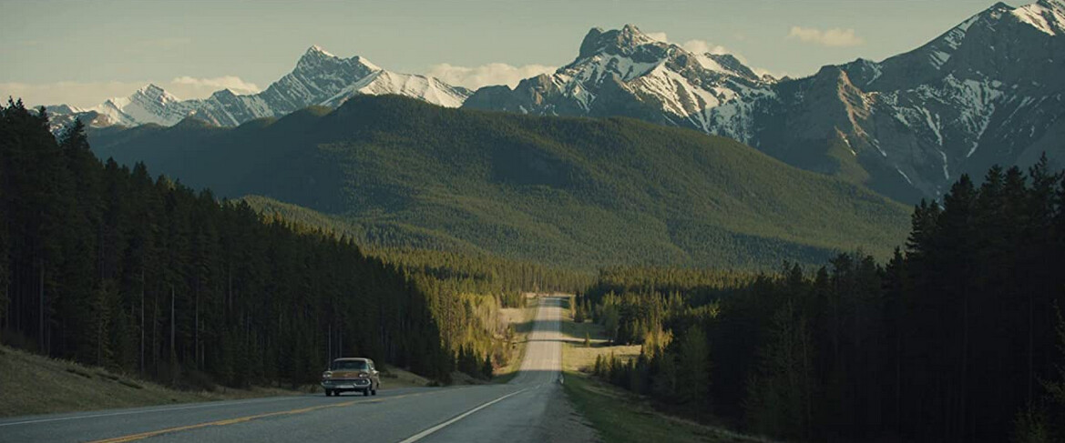 """Chevy station wagon with Rockie Mountains in background in """"Let Him Go"""""""