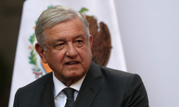 Mexico's President Andres Manuel Lopez Obrador addresses to the nation on his second anniversary as the President of Mexico, at the National Palace in Mexico City, Mexico, on Dec. 1, 2020. (Henry Romero/Reuters)