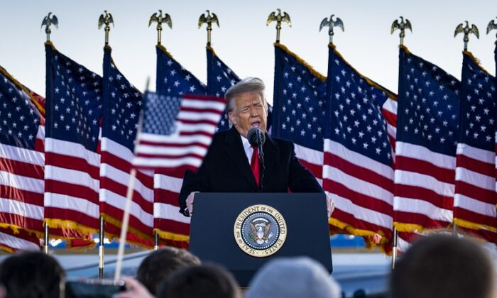 Then-President Donald Trump speaks to supporters at Joint Base Andrews before boarding Air Force One for his last time as President in Joint Base Andrews, Maryland on Jan. 20, 2021. (Pete Marovich - Pool/Getty Images)